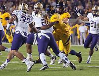 November 2nd, 2012: California's Michael Lowe tackles Washington's Bishop Sankey during a game at Memorial Stadium, Berkeley, Ca Washington defeated California 21 -13