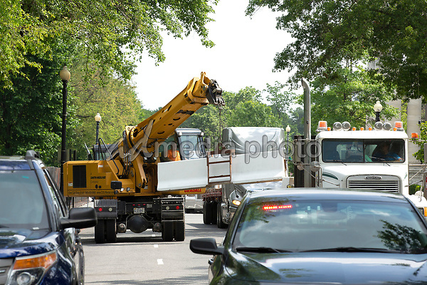 Crews remove additional barricades that were set up near the White House in Washington D.C., U.S., on Wednesday, June 10, 2020.  Additional fencing had been set up near the White House in response to the demonstrations caused by the death of George Floyd while he was in police custody on May 25, 2020.  Credit: Stefani Reynolds / CNP/AdMedia