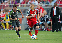 Seattle Sounders FC midfielder Brad Evans #3 and Toronto FC Alen Stevanovic #10 in action  during an MLS game between the Seattle Sounders FC and the Toronto FC at BMO Field in Toronto on June 18, 2011..The Seattle Sounders FC won 1-0.