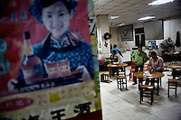 Advertisements cover the walls of a rest stop in rural Guangxi Province, China.