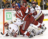Mike Brennan (Boston College - Smithtown, NY) takes care of Tyler Magura (Harvard University - Fargo, ND) while Pat Gannon (Boston College - Arlington, MA) falls over Cory Schneider (Boston College - Marblehead, MA). The Boston College Eagles defeated the Harvard University Crimson 3-1 in the first round of the 2007 Beanpot Tournament on Monday, February 5, 2007, at the TD Banknorth Garden in Boston, Massachusetts.  The first Beanpot Tournament was played in December 1952 with the scheduling moved to the first two Mondays of February in its sixth year.  The tournament is played between Boston College, Boston University, Harvard University and Northeastern University with the first round matchups alternating each year.