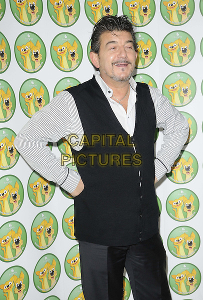 John Altman.attended the Burgess Wetnose Awards, Jumeirah Carlton Tower Hotel, Knightsbridge, London, England, UK, 9th March 2012..half length  black trousers waistcoat white striped shirt hands on hips beard facial hair funny .CAP/CAN.©Can Nguyen/Capital Pictures.