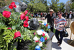 John and Jennie Wiberg place flowers on the state memorial following the annual Nevada Law Enforcement Officers Memorial Ceremony at the Capitol in Carson City, Nev., on Thursday, May 2, 2013. Their son John Wiberg II was a Washoe County Sheriff's Deputy killed in an on-duty accident in 2004. (AP Photo/Cathleen Allison)