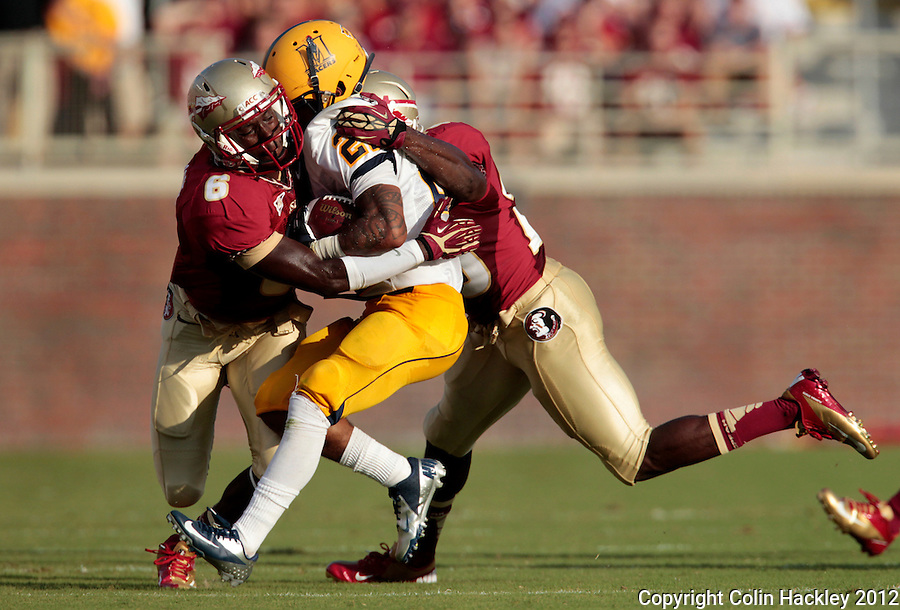 TALLAHASSEE, FL 9/1/12-FSU-MURRAY090112CH-Florida State's Nick Waisome, left, and Lamarcus Joyner, right, sandwich Murray State's Jordan Morrow during first half action Saturday at Doak Campbell Stadium in Tallahassee. .COLIN HACKLEY PHOTO