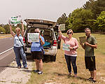 May 5, 2018. Fayetteville, North Carolina.<br /> <br /> (left to right) Katie Gallagher, Debra Grabauskas, Vanessa Hall and Jon Hall hold signs about the GenX pollution of the Cape Fear River on Hwy. 87 just outside the Chemours plant which has been dumping GenX unregulated into the river for years. <br /> <br /> The Chemours Company, a spin off from DuPont, manufactures many chemicals at its plant in Fayetteville, NC. One of these, commonly referred to as GenX, is part of the process of teflon manufacturing. Chemours has been accused of dumping large quantities of GenX into the Cape Fear River and polluting the water supply of city's down river and allowing GenX to leak into local aquifers.