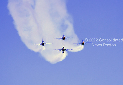 F-16 Fighting Falcon aircraft operated by the United States Air Force &quot;Thunderbirds&quot; perform at the Joint Base Andrews Air Show at Joint Base Andrews, Maryland on Friday, September 15, 2017. The Thunderbirds are assigned to the 57th Wing, and are based at Nellis Air Force Base, Nevada.<br /> Credit: Ron Sachs / CNP