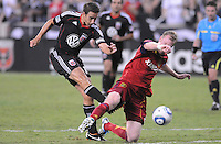 D.C. United forward Josh Wolff (16) goes against Real Salt Lake defender Nat Borchers (6). D.C. United defeated Real Salt Lake 4-1 at RFK Stadium, Saturday September 24 , 2011.