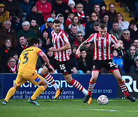 Lincoln City's Harry Anderson vies for possession with Northampton Town's David Buchanan<br /> <br /> Photographer Andrew Vaughan/CameraSport<br /> <br /> Emirates FA Cup First Round - Lincoln City v Northampton Town - Saturday 10th November 2018 - Sincil Bank - Lincoln<br />  <br /> World Copyright © 2018 CameraSport. All rights reserved. 43 Linden Ave. Countesthorpe. Leicester. England. LE8 5PG - Tel: +44 (0) 116 277 4147 - admin@camerasport.com - www.camerasport.com