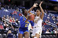 GREENSBORO, NC - MARCH 04: Rita Igbokwe #23 of the University of Pittsburgh drives past Mikayla Vaughn #30 of Notre Dame University during a game between Pitt and Notre Dame at Greensboro Coliseum on March 04, 2020 in Greensboro, North Carolina.