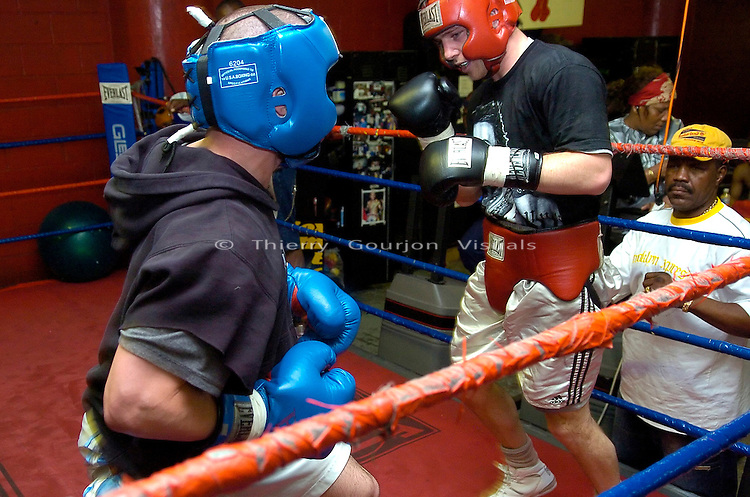 John Duddy (red) sparring with Golden Gloves winner Will Rosinsky  at Gleason's Gym in Brooklyn, NY on 05.31.06. Duddy is preparing for his upcoming WBC Continental Americas Middleweight Championship fight against Freddy Cuevas at MSG on June 10th, 2006.