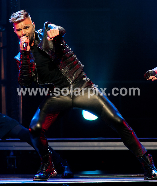 **ALL ROUND PICTURES FROM SOLARPIX.COM**                                             **SYNDICATION RIGHTS FOR UK, AUSTRALIA, DENMARK, PORTUGAL, S. AFRICA, SPAIN & DUBAI (U.A.E) & ASIA (EXCLUDING JAPAN) ONLY**                                                                                  Caption: Ricky Martin in Concert at the American Airlines Arena in Miami, USA. 9 April 2011                                                                              This pic: Ricky Martin                                                                                          JOB REF: 13121 PHZ  Harris    DATE: 09_04_2011                                                           **MUST CREDIT SOLARPIX.COM OR DOUBLE FEE WILL BE CHARGED**                                                                      **MUST AGREE FEE BEFORE ONLINE USAGE**                               **CALL US ON: +34 952 811 768 or LOW RATE FROM UK 0844 617 7637**
