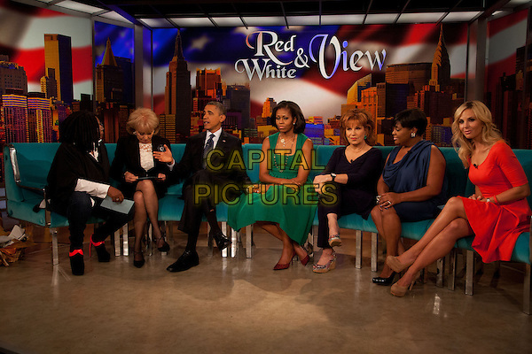 """Whoopi Goldberg, Barbara Walters, President Obama, First Lady Michelle Obama, Joy Behar, Sherri Shepherd and Elisabeth Hasselbeck.United States President Barack Obama &  Michelle Obama visit the set of """"The View"""" on ABC-TV, New York, New York, USA..24th September 2012.full length sitting black green red suit profile dress couch sofa interview holding hands arms in lap married husband wife .CAP/ADM/CNP/AT.©AT/CNPAdMedia/Capital Pictures."""
