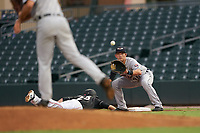 Lakeland Flying Tigers first baseman Nick Ames (46) waits for a throw as Connor Scott (25) dives back to the bag during a Florida State League game against the Jupiter Hammerheads on August 12, 2019 at Roger Dean Chevrolet Stadium in Jupiter, Florida.  Jupiter defeated Lakeland 9-3.  (Mike Janes/Four Seam Images)