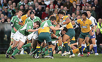 Australian number 8 Michael Uoka is driven back by the Irish pack during the Division A U19 World Championship clash at Ravenhill.