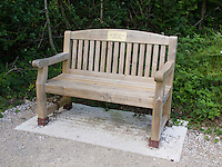 New public bench set in concrete and chained up to prevent theft, Arnside, Lancashire, UK.