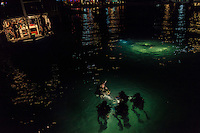 19 February, 2013 - Koh Rong (Sihanoukville). A group of deminers makes practice during a night diving in the port of Koh Rong. © Thomas Cristofoletti / Ruom