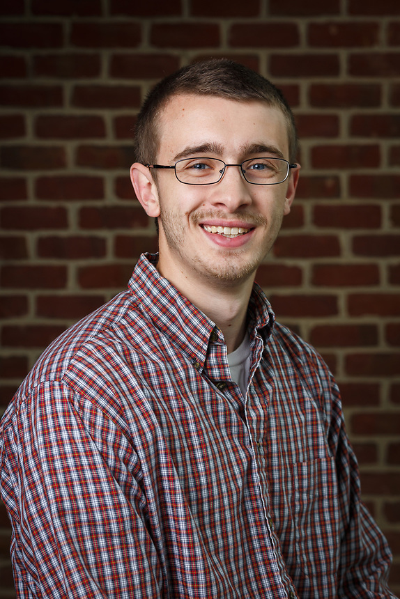 Jordan Tillas of IT Communication is photographed for headshot day on May 23, 2017. (Photo by Caroline Cummings)