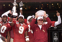 NEW ORLEANS, LA 1/4/00-Florida State's Peter Warrick, second from left, Coach Bobby Bowden and other Seminoles celebrate winning the National Championship after defeating Virginia Tech in the Sugar Bowl. COLIN HACKLEY PHOTO