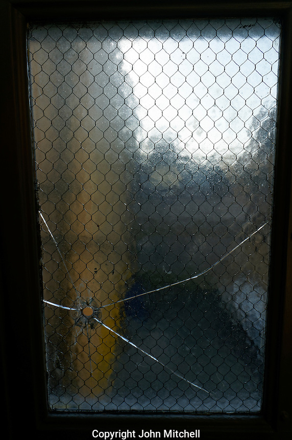 Bullet hole in window of the autopsy room of the former Vancouver morgue, Vancouver Police Museum, Vancouver, BC, Canada
