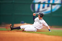 NW Arkansas third baseman Hunter Dozier (9) slides into second after hitting a double during a game against the San Antonio Missions on May 30, 2015 at Arvest Ballpark in Springdale, Arkansas.  San Antonio defeated NW Arkansas 5-1.  (Mike Janes/Four Seam Images)