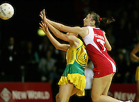 16.11.2007 England's Jade Clarke and Australian Natalie von Bertouch in action during the Australia v England match at the New World Netball World Champs held at Trusts Stadium Auckland New Zealand. Mandatory Photo Credit ©Michael Bradley.