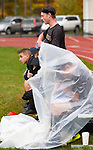 THOMASTON,  CT-101619JS13-Thomaston players, including some taking shelter from the rain, watch the game from the sidelines during their Berkshire League match up with Terryville Wednesday at Nystrom Park in Thomaston.<br /> Jim Shannon Republican-American