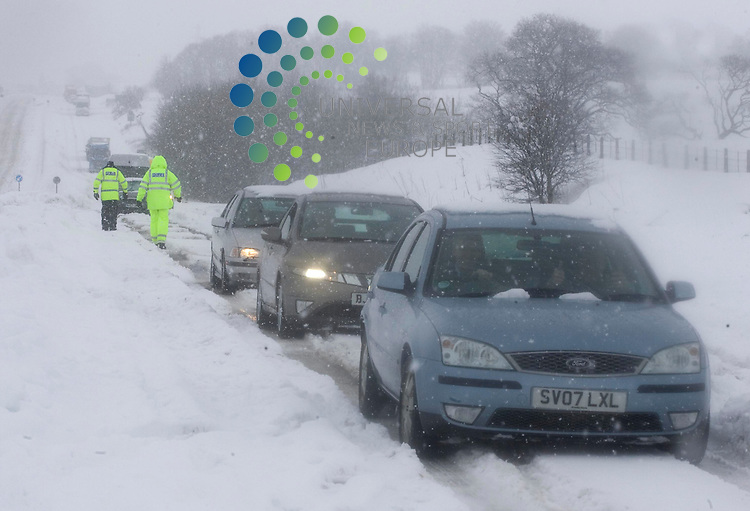 Police look at the the motorists that are stuck on the A9 in Perthshire by heavy snow and fallen electricity lines, police have said..The problems have affected the north and southbound lanes between the Broxden and Keir roundabouts..Tayside Police said members of the public with four-wheeled drive vehicles were helping to bring food and drinks to the motorists..Snow has also disrupted rail services between central and north Scotland..Bear Scotland has sent a fleet of 12 snow ploughs and gritters to clear the road where motorists were stuck on the A9..25 February 2010 Picture: Maurice McDonald,Universal News And Sport (Scotland)...