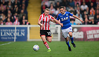 Lincoln City's Danny Rowe vies for possession with Macclesfield Town's David Fitzpatrick<br /> <br /> Photographer Chris Vaughan/CameraSport<br /> <br /> The EFL Sky Bet League Two - Lincoln City v Macclesfield Town - Saturday 30th March 2019 - Sincil Bank - Lincoln<br /> <br /> World Copyright © 2019 CameraSport. All rights reserved. 43 Linden Ave. Countesthorpe. Leicester. England. LE8 5PG - Tel: +44 (0) 116 277 4147 - admin@camerasport.com - www.camerasport.com