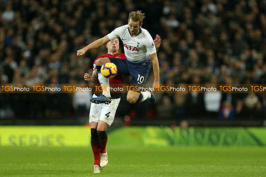 Harry Kane of Tottenham Hotspur and Phil Jones of Manchester United during Tottenham Hotspur vs Manchester United, Premier League Football at Wembley Stadium on 13th January 2019