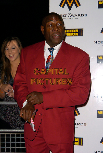 FRANK BRUNO.The MOBO (Music Of Black Origin) Awards 2007 at the O2 Arena, London, England..September 19th, 2007.mobos half length red pink suit.CAP/CAN.©Can Nguyen/Capital Pictures
