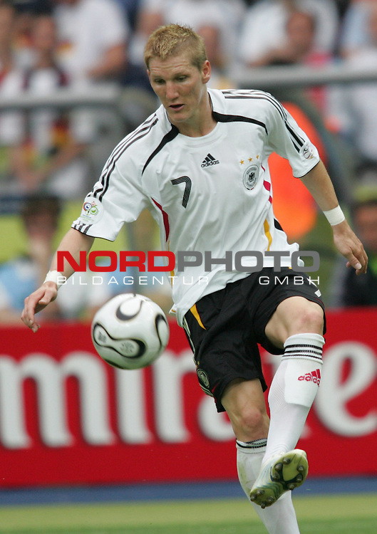 FIFA WM 2006 - Quarter-finals / Viertelfinale<br /> Play #57 (30-Jun) - Germany vs Argentina.<br /> Bastian Schweinsteiger from Germany stopps the ball during the match of the World Cup in Berlin.<br /> Foto &copy; nordphoto