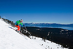 Spring skiing at Alpine Meadows ski resort, California, with Lake Tahoe in the background.
