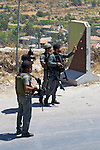 An Israeli army officer warns a Palestinian not to throw stones following a demonstration at the entrance to the village of Beit Ummar near Hebron on 05.06.2010. Moments earlier stones had been thrown at the soldiers which only resulted in minor injuries to a member of the press.