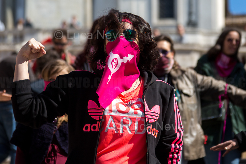 "Rome, 08/03/2020. Today, ""NonUnaDiMeno"" (Not One Woman Less) held the a flash mob (1.) on the globally famous Spanish Steps of Piazza di Spagna in Rome. Given, the Coronavirus (SARS-CoV-2 – infection: COVID-19) epidemic Emergency the planned flash mob of the the song-performance ""Un violador en tu camino"" of the Chilean feminist group Las Tesis (2.) was postponed to when the crisis is contained and hopefully the virus defeated. The aim of the transfemminist flash mob was to mark the 8 of March, International Women's Day, to protest gender-based, economic and racial violence against women, feminicides (Femminicidio), against patriarchy, to be supporting abortion's rights (via protecting the Legge 194 - Law 194, 3.) and self-determination.<br />