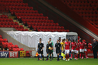 Referee, Nicholas Kinseley, leads out the two teams in front of a sparse crowd during Charlton Athletic vs Portsmouth, Checkatrade Trophy Football at The Valley on 7th November 2017