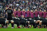 The England team watch as New Zealand perform the haka prior to the match. QBE International match between England and New Zealand on November 8, 2014 at Twickenham Stadium in London, England. Photo by: Patrick Khachfe / Onside Images