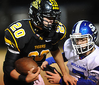 NWA Democrat-Gazette/ANDY SHUPE<br /> Blake Faulk (20) of Prairie Grove carries the ball as Austin Powell (right) of Star City attempts to make the tackle Friday, Nov. 27, 2015, during the first half of play at Tiger Stadium in Prairie Grove. Visit nwadg.com/photos to see more photographs from the game.