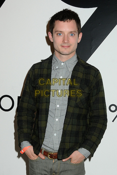 Elijah Wood.All In For The 99 Percent Event hosted by Van Jones, Rebuild The Dream and MoveOn.org held at 400 S La Brea, Los Angeles, California, USA, .31st March 2012..half length green tartan plaid jacket grey gray shirt jeans brown belt .CAP/ADM/BP.©Byron Purvis/AdMedia/Capital Pictures.