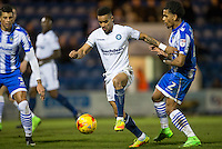 Paris Cowan-Hall of Wycombe Wanderers holds off Richard Brindley of Colchester United during the Sky Bet League 2 match between Colchester United and Wycombe Wanderers at the Weston Homes Community Stadium, Colchester, England on 21 February 2017. Photo by Andy Rowland / PRiME Media Images.
