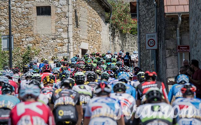 peloton twisting through the narrow village streets<br /> <br /> Stage 6: Le parc des oiseaux/Villars-Les-Dombes &rsaquo; La Motte-Servolex (147km)<br /> 69th Crit&eacute;rium du Dauphin&eacute; 2017