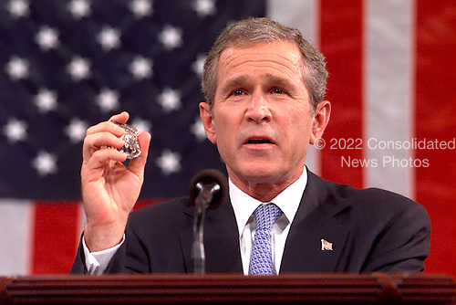 Washington, DC - September 20, 2001 -- U.S. President George W. Bush holds the Police Badge of George Howard, who died at the World Trade Center trying to save others as he spoke before a Joint Session of Congress to detail his plan to combat terrorism.  Howard's badge was given to the President by his mother, Arlene..Credit: Win McNamee - Pool / CNPWashington, DC - September 20, 2001 -- U.S. President George W. Bush holds the Police Badge of George Howard, who died at the World Trade Center trying to save others as he spoke before a Joint Session of Congress at the Capitol in Washington, D.C. on September 20, 2001 to detail his plan to combat terrorism.  Howard's badge was given to the President by his mother, Arlene..Credit: Win McNamee - Pool via CNP