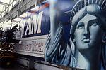 Billboardpainterworkingon ad for Pan Am airlines