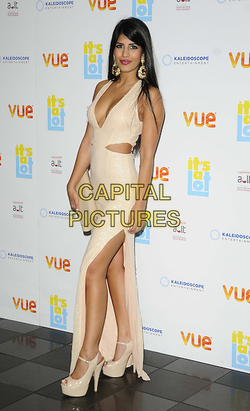 Jasmin Walia<br /> The &quot;It's A Lot&quot; UK film premiere, Vue West End cinema, Leicester Square, London, England.<br /> October 21st, 2013<br /> full length white dress slit split  cut out away cream cleavage low cut neckline clutch bag side <br /> CAP/CAN<br /> &copy;Can Nguyen/Capital Pictures