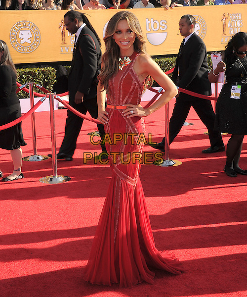Giuliana Rancic.18th Annual Screen Actors Guild Awards held at The Shrine Auditorium, Los Angeles, California, USA..January 29th, 2012.SAG SAGS full length red dress sleeveless hands on hips.CAP/RKE/DVS.©DVS/RockinExposures/Capital Pictures.