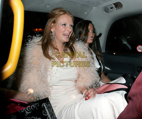 "OLIVIA INGE & PIPPA MIDDLETON.Leaving The ""End of Summer Ball"" at Berkeley Square, London, England. .September 25th 2008.half length white pink fur wrap feather dress car cab taxi sitting mouth open funny face .CAP/AH.©Adam Houghton/Capital Pictures."