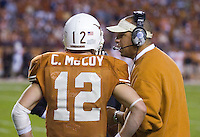 04 November 2006: Texas quarterback Colt McCoy (#12) gets some advice from an assistant coach during the Longhorns 36-10 victory over the Oklahoma State University Cowboys at Darrel K Royal Memorial Stadium in Austin, Texas.