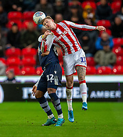 11th January 2020; Bet365 Stadium, Stoke, Staffordshire, England; English Championship Football, Stoke City versus Milwall FC; James McClean of Stoke City heads the ball over Mahlon Romeo of Millwall - Strictly Editorial Use Only. No use with unauthorized audio, video, data, fixture lists, club/league logos or 'live' services. Online in-match use limited to 120 images, no video emulation. No use in betting, games or single club/league/player publications