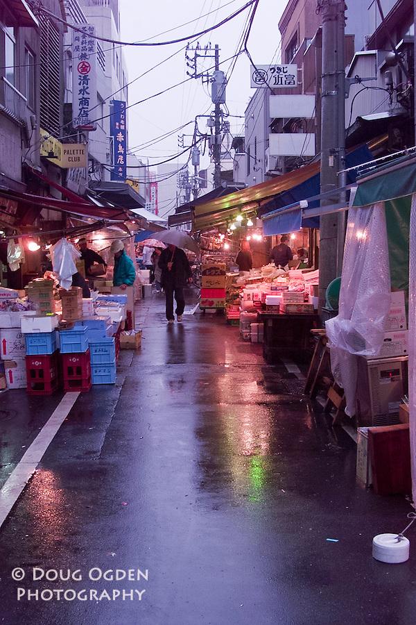A rainy morning at the Street Markets outside the Tsukiji fish market, Tokyo Japan