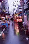 A rainy morning at the Street Markets outside the Tsukiji fish market, Tokyo Japan