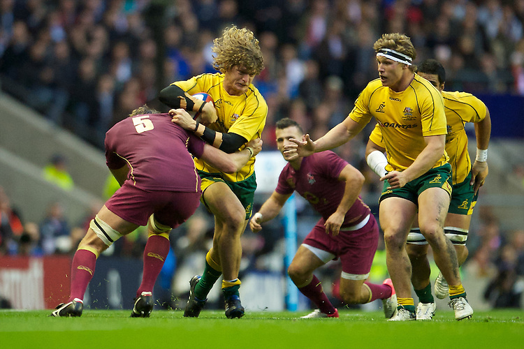 Nick Cummins of Australia is tackled by Geoff Parling of England as Michael Hooper of Australia (right) supports during the Cook Cup between England and Australia, part of the QBE International series, at Twickenham on Saturday 17th November 2012 (Photo by Rob Munro)